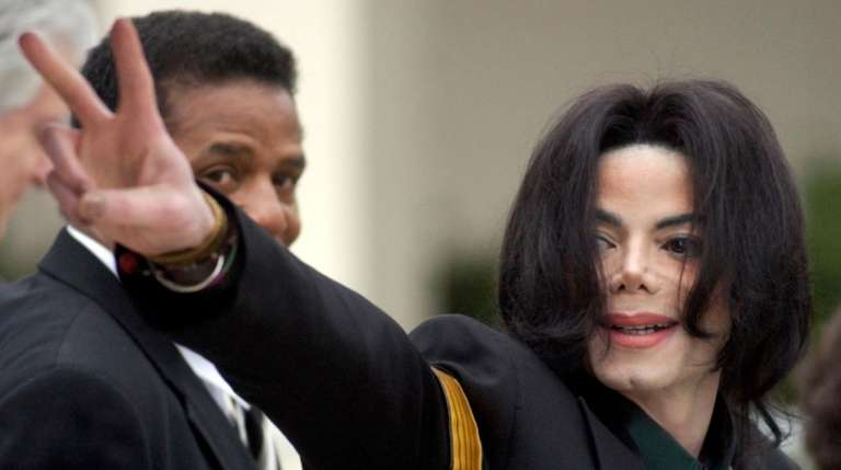 Pop icon Michael Jackson waves to his supporters