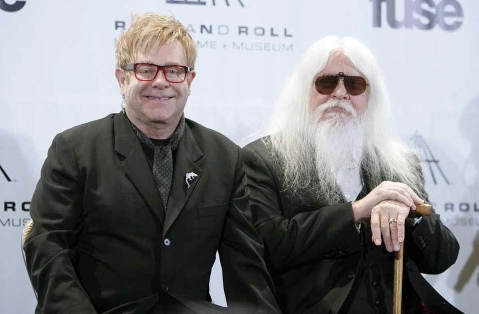 Elton John, left, and Leon Russell appear backstage