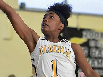 Tyasia Williams #1 of Uniondale scores on a