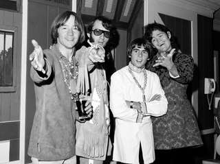 Peter Tork, far left, with Mike Nesmith, Davy