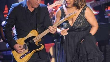 Musician Bruce Springsteen and inductee Darlene Love perform