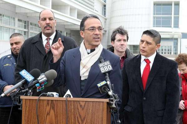 Immigration advocates, including The Rev. Allan Ramirez, hold