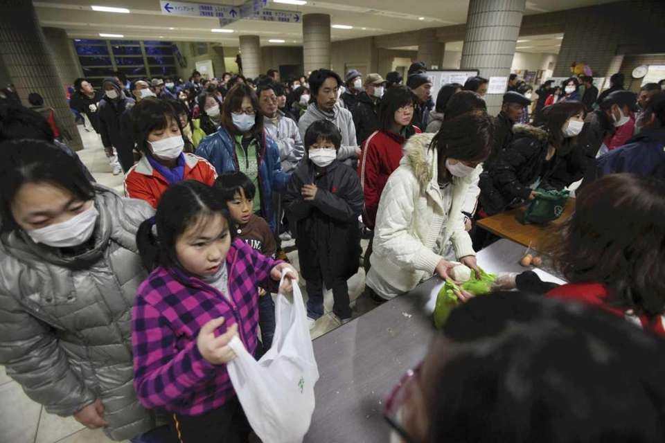 Evacuees crowd a makeshift shelter in Fukushima, northern