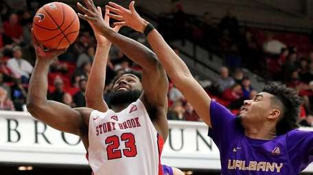 Stony Brook guard Andrew Garcia gets fouled on