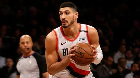 Enes Kanter of the Trail Blazers controls the