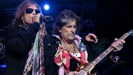 Singer Steven Tyler performs with musician Joe Perry