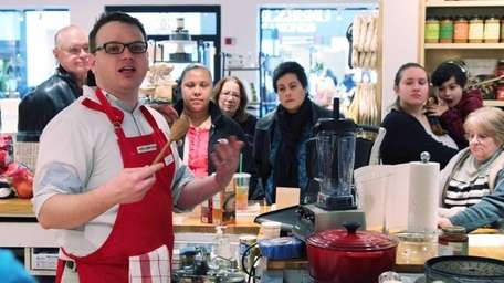 Aaron Bokros leads a free cooking class on