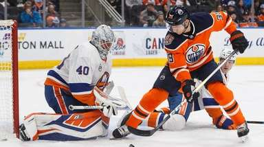 Islanders goalie Robin Lehner makes a save against