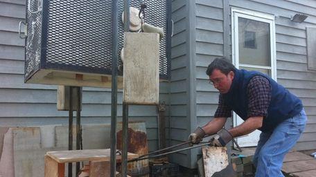 Joseph Mitrani, owner of Greenport Pottery, takes a