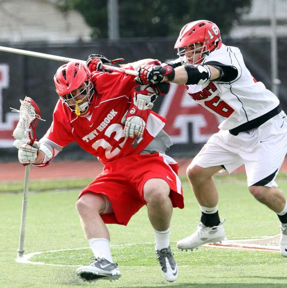 Stony Brook's Tom Compitello manages to get past