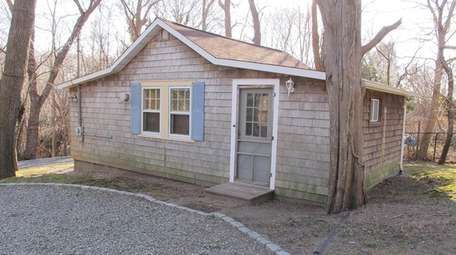 The property comes with a separate, one-bedroom cottage.