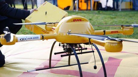 DHL partner Daniel Knoche of microdrones stands next