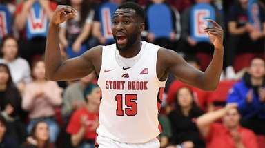 Stony Brook guard Akwasi Yeboah reacts against Vermont