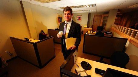 Paul M. Klass in the cubicle area of
