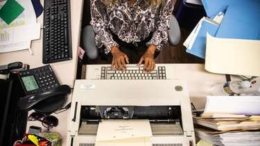 A Hempstead Town employee at her desk in