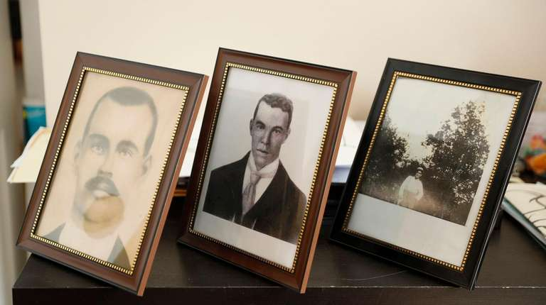 Photographs of Denice Sheppard's relatives are displayed at