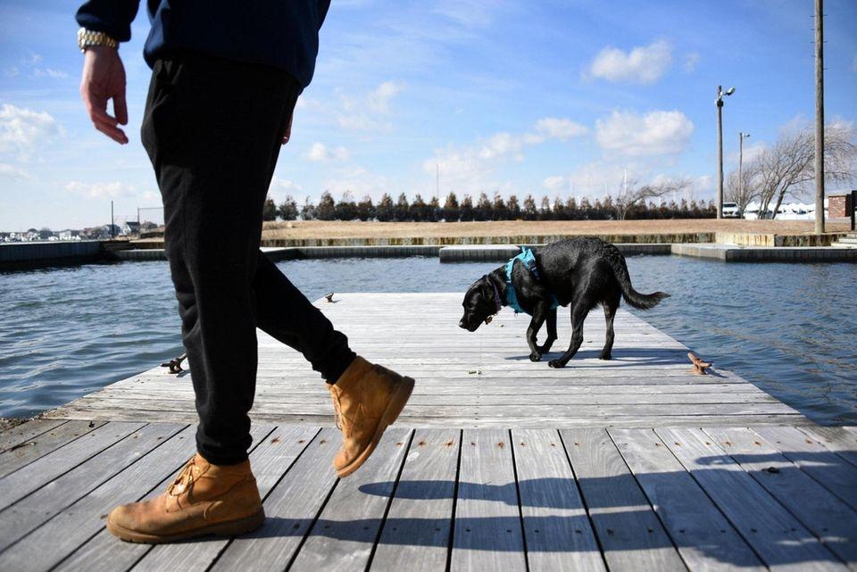 Rob Balkam, 25, of Lindenhurst, walks with his