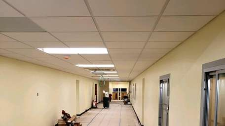 Corridor floors at Hempstead's Prospect School are covered