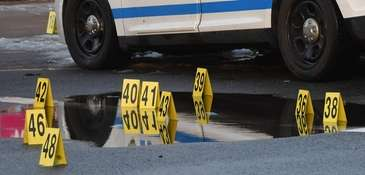 Markers show spots where spent casings were found
