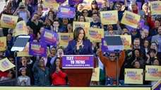 Democratic Sen. Kamala Harris, of California, acknowledges the