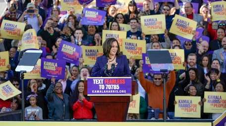 Democratic Sen. Kamala Harris, of California, acknowledges the