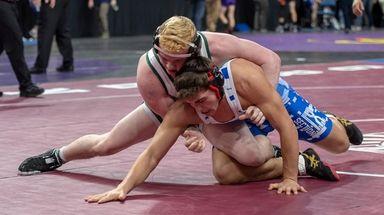 Pat Quinn of Seaford High School wrestling in