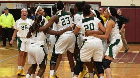 Longwood players celebrate their win against Northport in