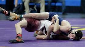 Rick Delia Port Jefferson wrestles Mason Bush10.Central Valley