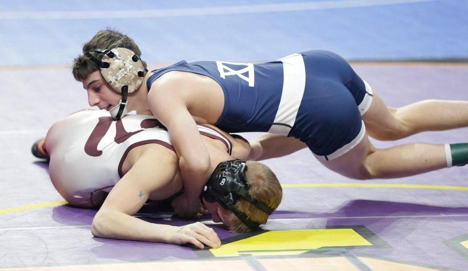 Chris Petteys Hudson Falls wrestles Joe Sparacio9 Bayport-Blue