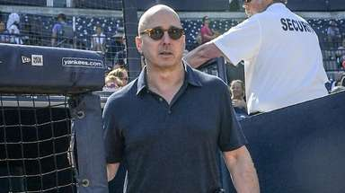 Yankees general manager Brian Cashman takes the field