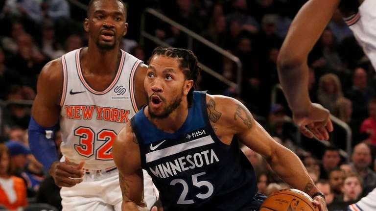 Derrick Rose of the Timberwolves drives to the