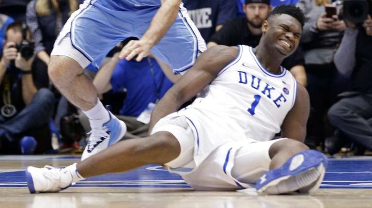 Duke's Zion Williamson falls to the floor with