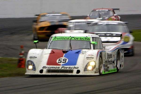 Hurley Haywood (59) leads a group of cars