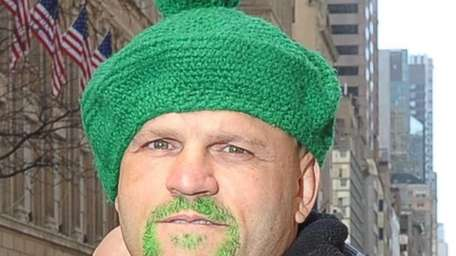 Retired MMA fighter Chuck Liddell marches in the