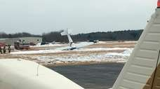 A small plane is seen resting on its