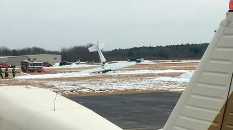 A small plane rests on its nose following