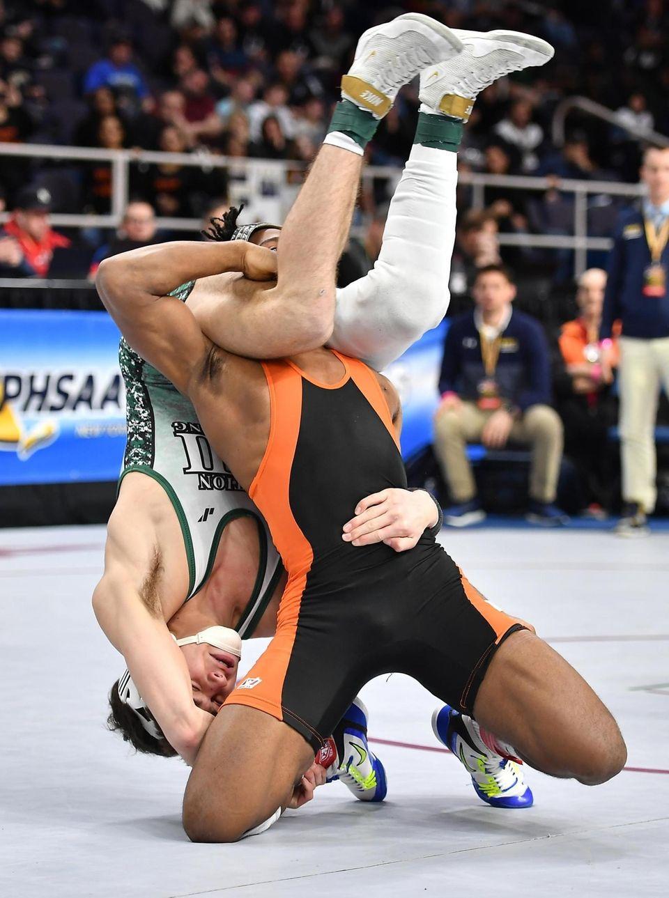 Kyle Althenn, Mepham, green, wrestling Willie McDougald in