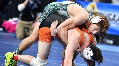 Kyle Mosher, South Side/East Rockaway, green, wrestling against