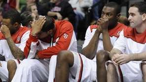 St. John's players watch from the bench late