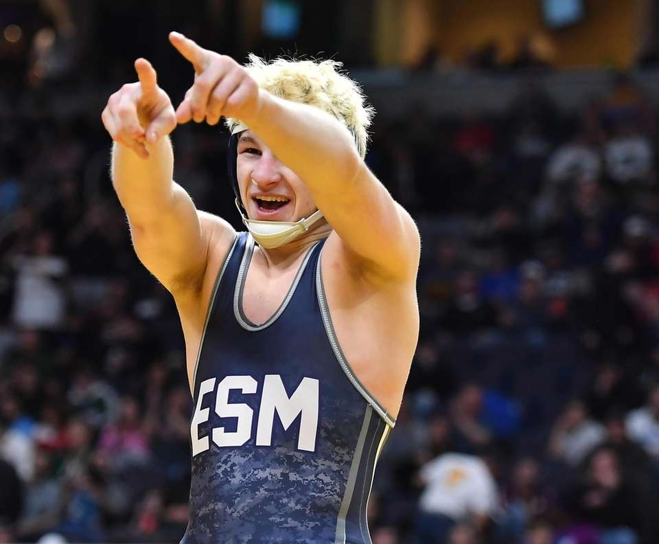 Adam Busiello, Eastport-South Manor pins his opponent and