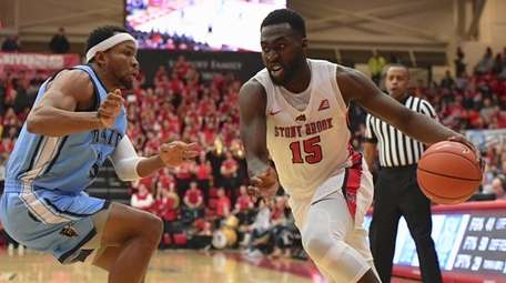 Stony Brook guard Akwasi Yeboah drives the ball