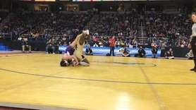 Uniondale's Xavier Pommels falls to Victor's Alex Samson,