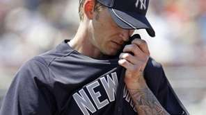 New York Yankees starting pitcher A.J. Burnett wipes