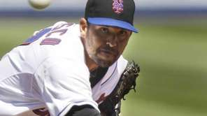 New York Mets pitcher D.J. Carrasco throws during