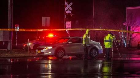 Police at the East Patchogue crash scene on