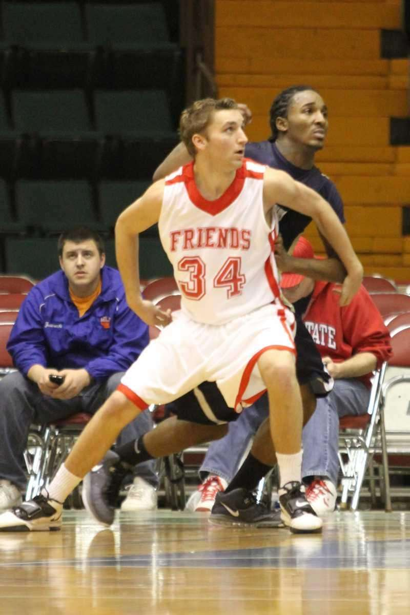 Friends Academy's Bennett Felder boxes out a Greenwich