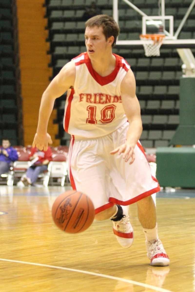 Friends Academy's T.J. Hefele dribbles down the court
