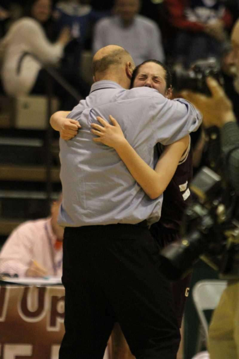 Garden City coach Anthony Sparcia consoles Katie Trimmer