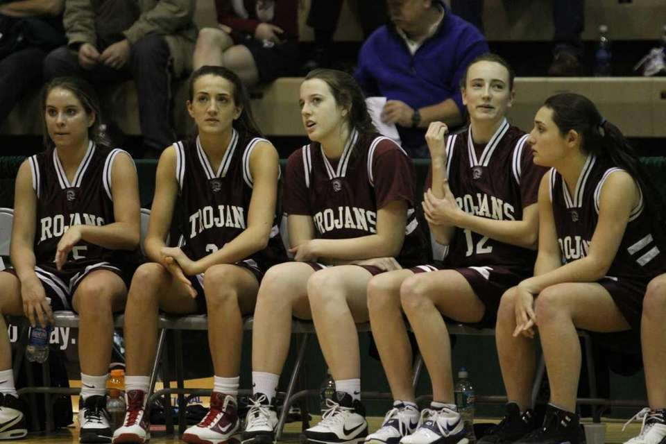 Garden City teammates watch the game from the