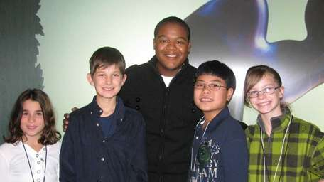 Actor Kyle Massey with Kidsday reporters, from left,